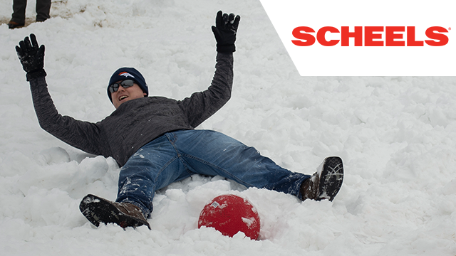 kickball player laying in the snow