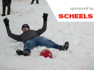 kickball player laying in snow