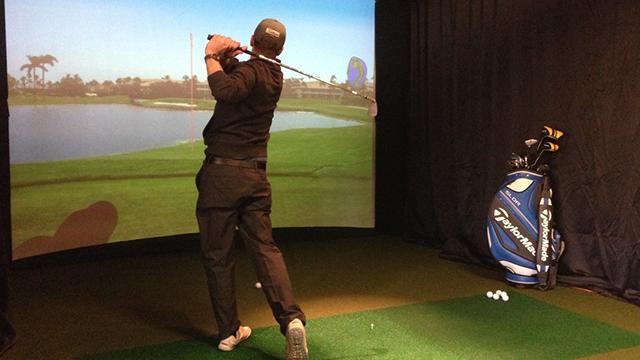 man playing golf simulator