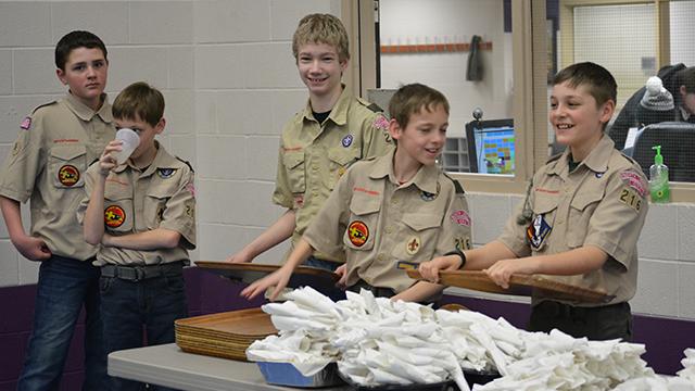 Boy Scouts serving chili