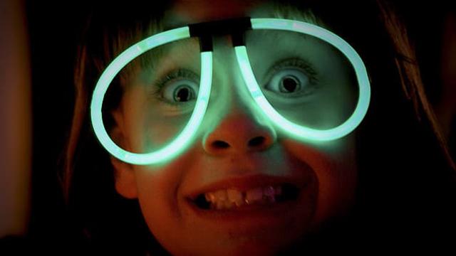 kid with glow sticks